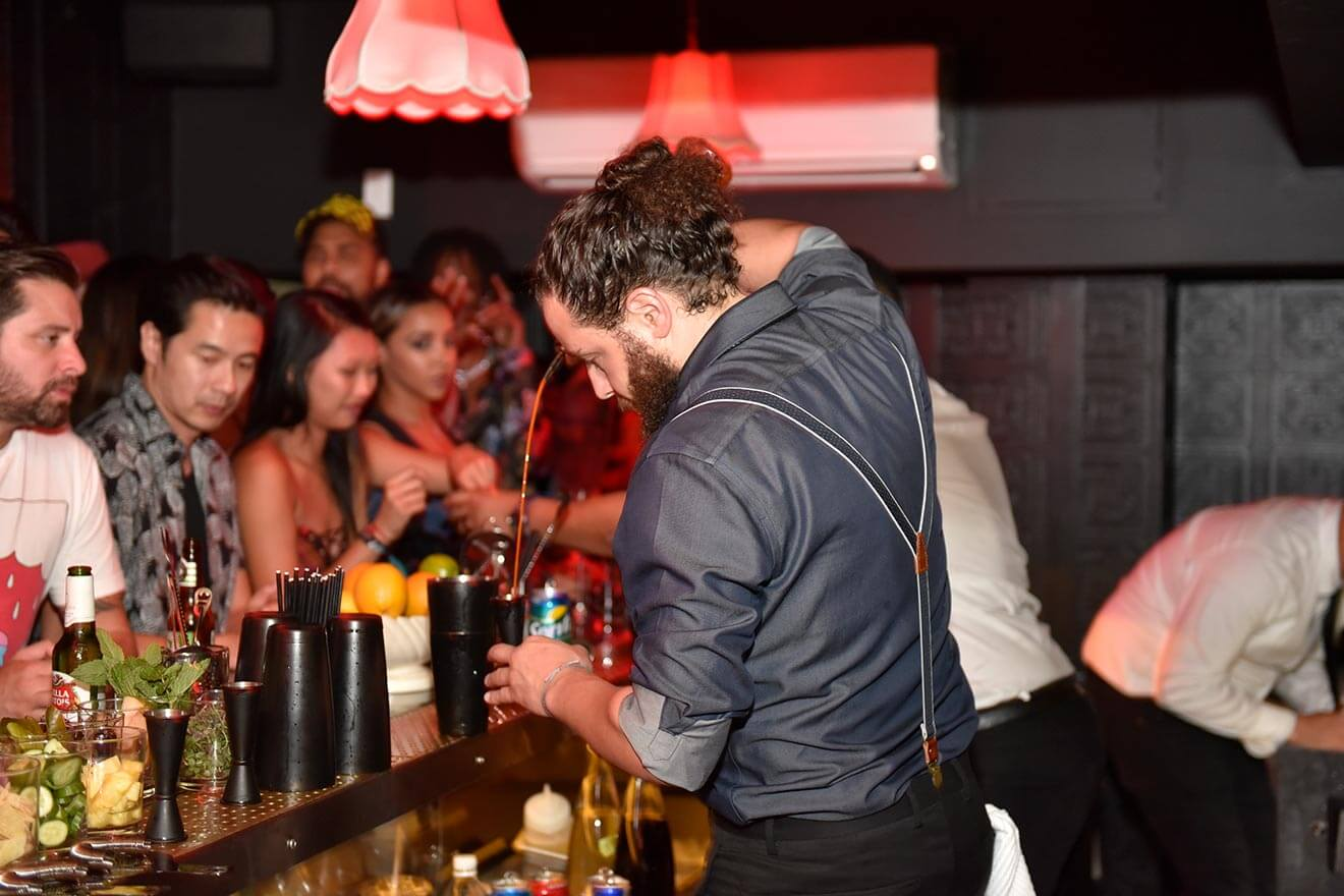 justin campbell, pouring drinks for a crowd
