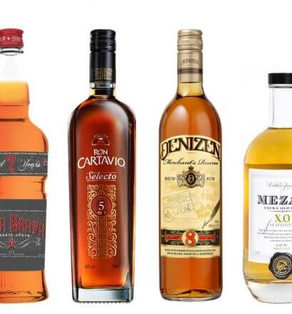 6 Rich Rums for Winter Sipping, bottles on white, featured image