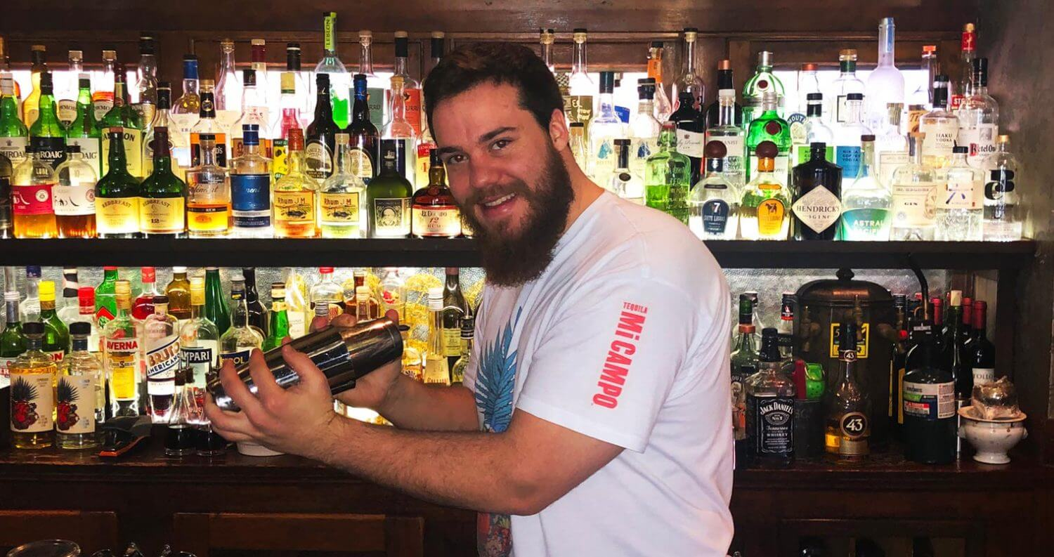 Cameron Masden behind the bar shaking, featured image