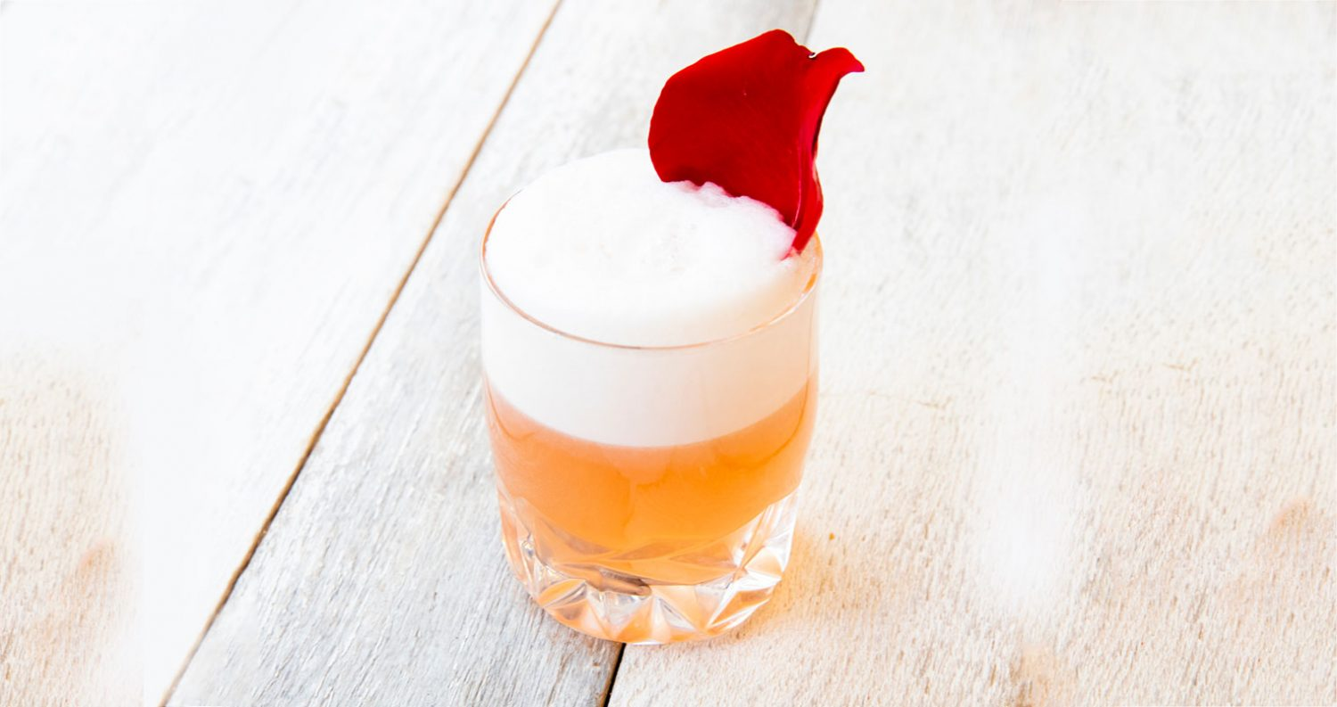 Cupid's CBD Fizz with flower garnish, featured image