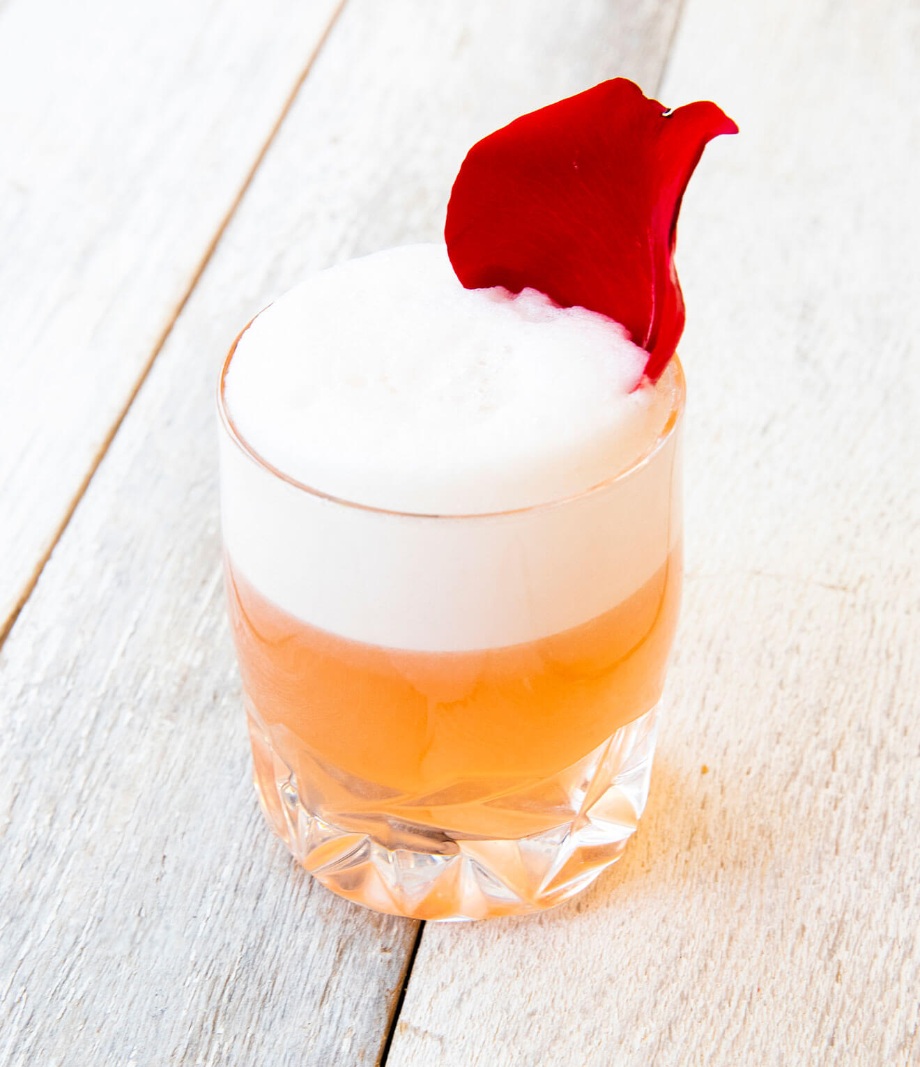 Cupid's CBD Fizz with flower garnish