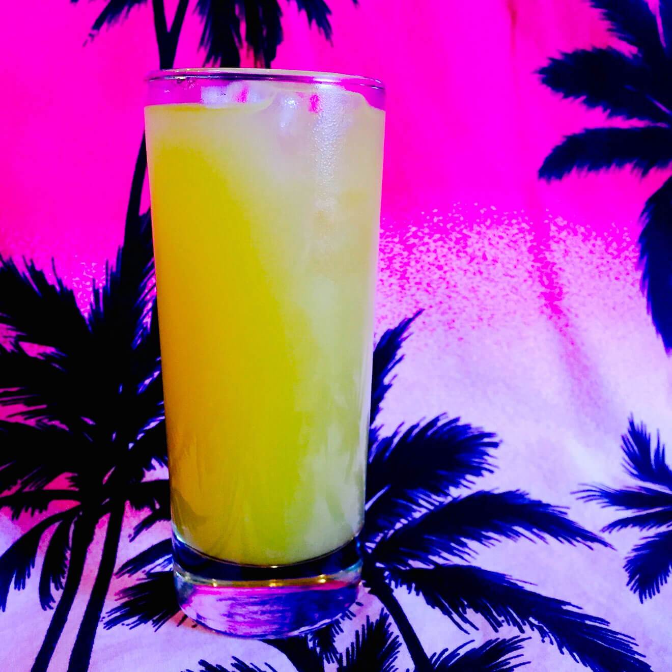 Delhi Cooler cocktail with tropical 80's background