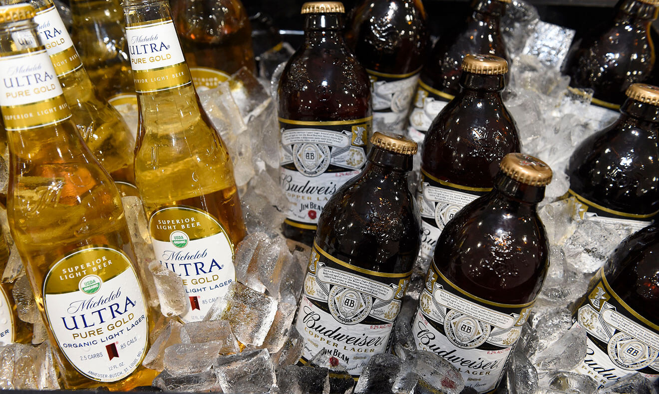 Michelob Ultra Pure Gold and Budweiser Copper Lager, bottles on ice