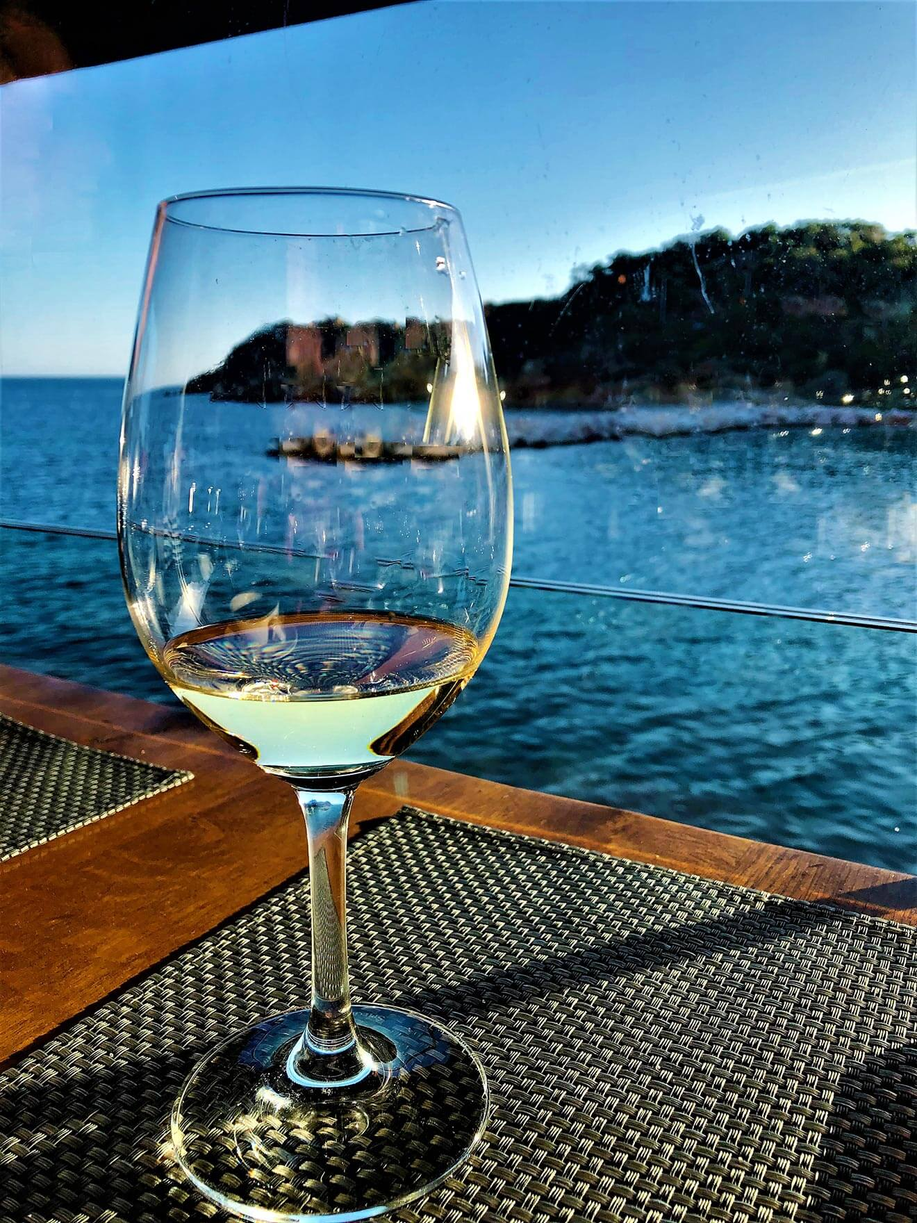 Moorings Restaurant, wine glass, view of the harbor