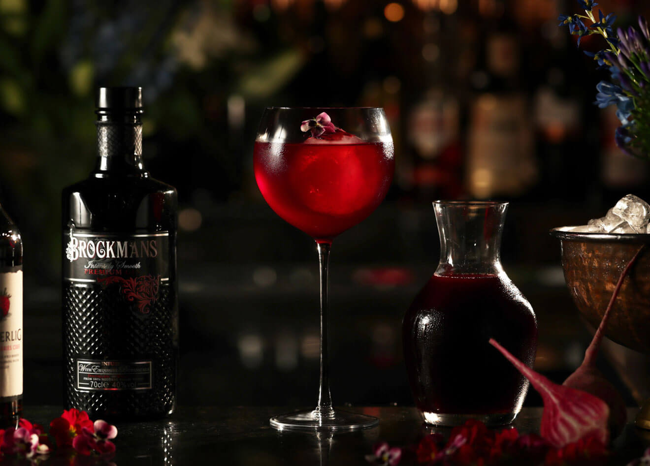 Purple Spring, cocktail with garnishes, dark background