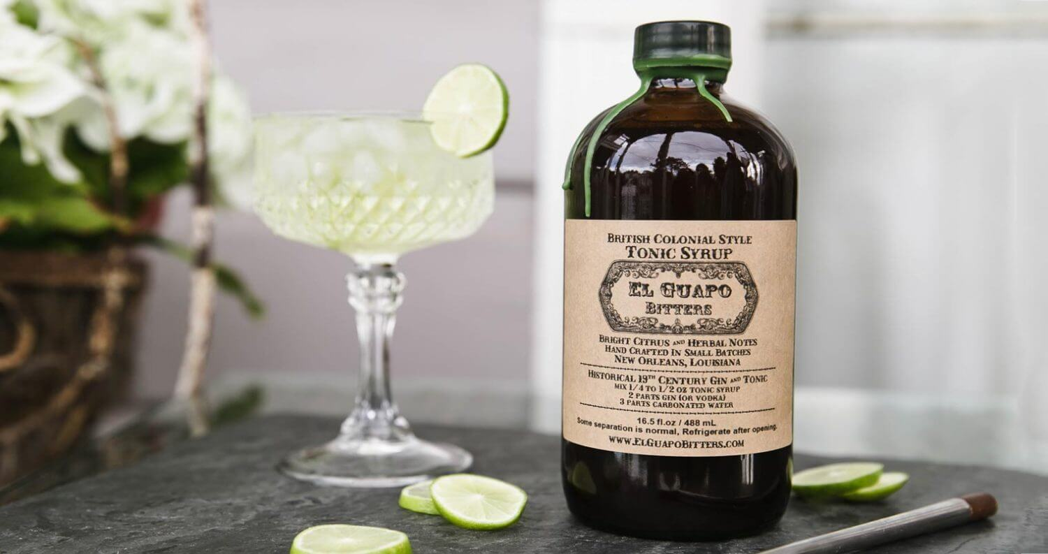 British Colonial Style Tonic Syrup, bottle and cocktail with garnish, featured image