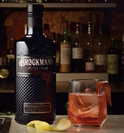 Brockmans 2018 Winner - Betty Brown, cocktail, bottle on table, dark background, featured image