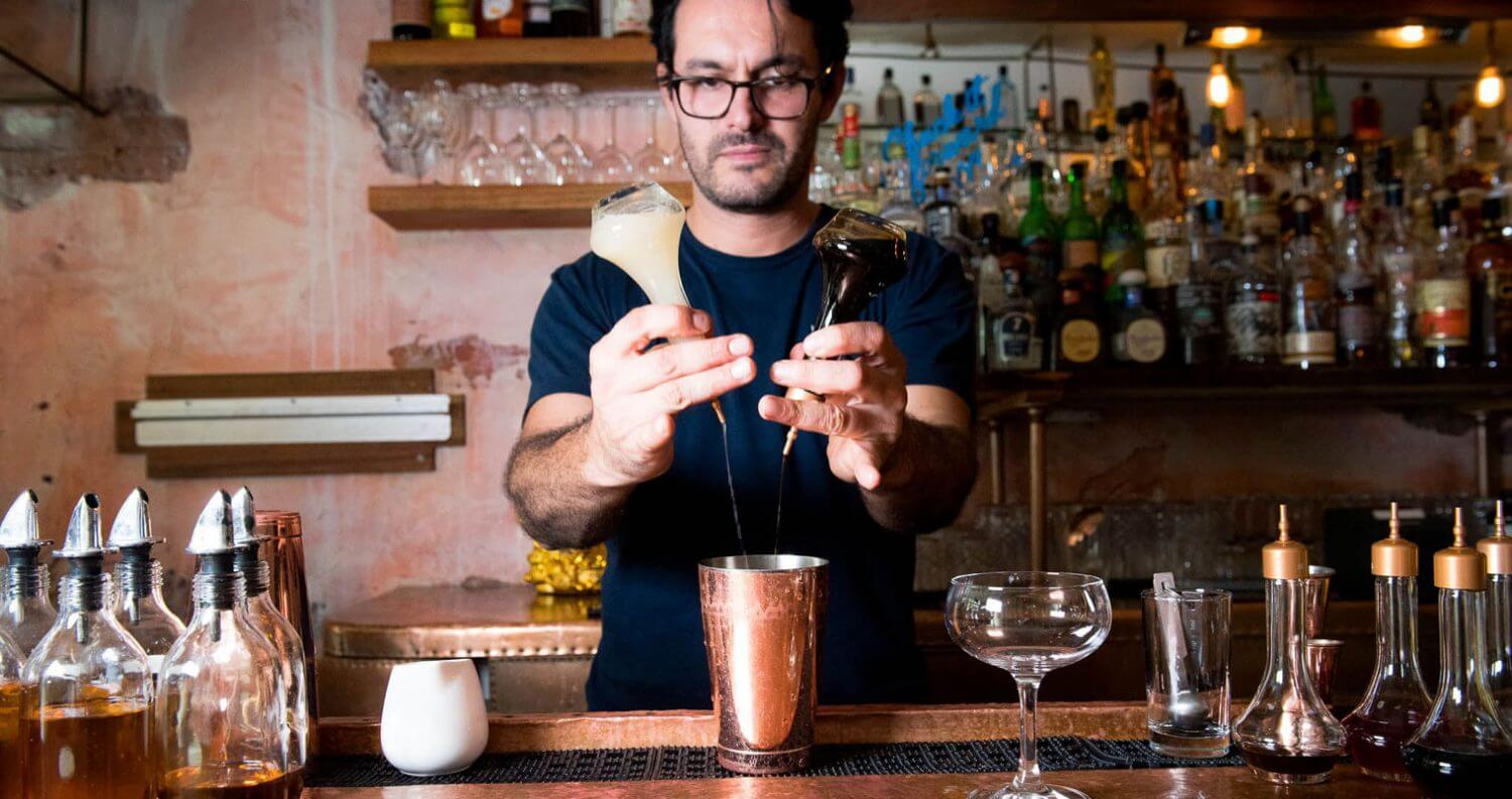 Federico Avila mixing a cocktail behind the bar, featured image