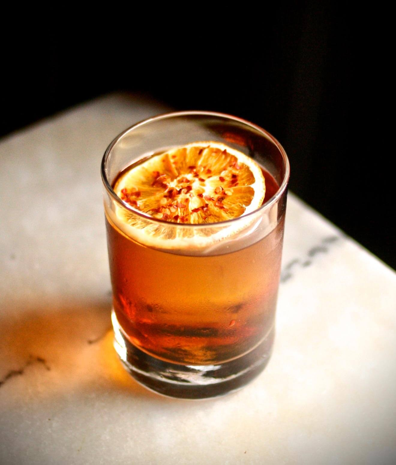 Gaucho With a Vengeance, cocktail with dried fruit garnish