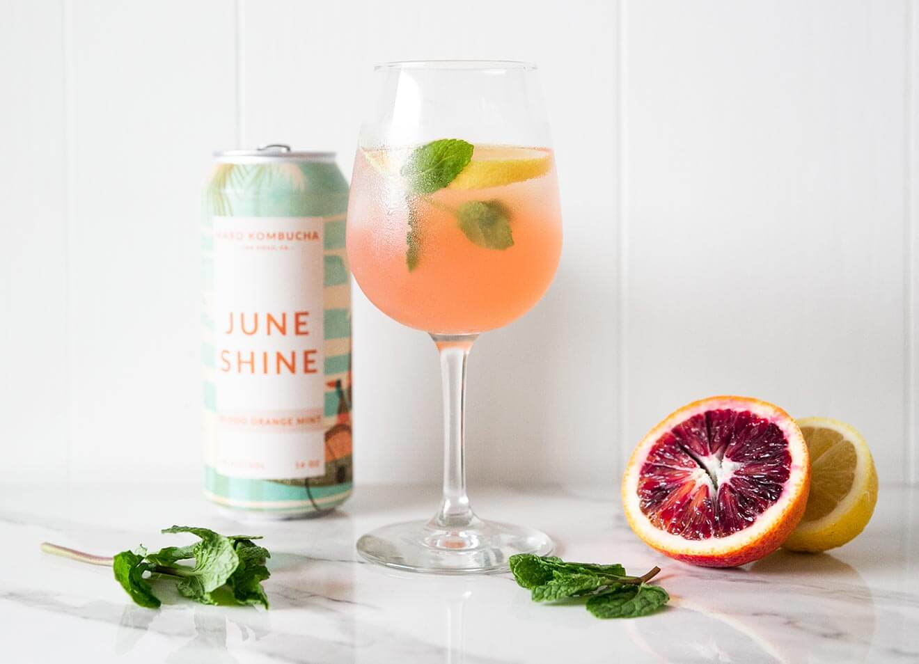 JuneShine Spritz, bottle, cocktail and fruit garnish