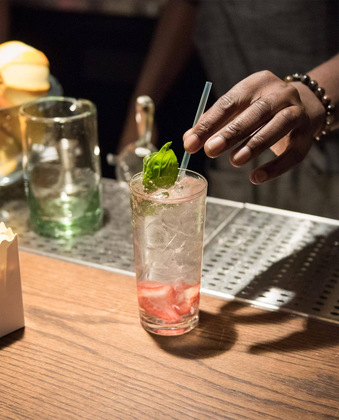 Skinny Rabbit cocktail being mixed and garnished by barman