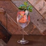 Skinny Spritzer cocktaial with strawberry and mint garnish, featured image