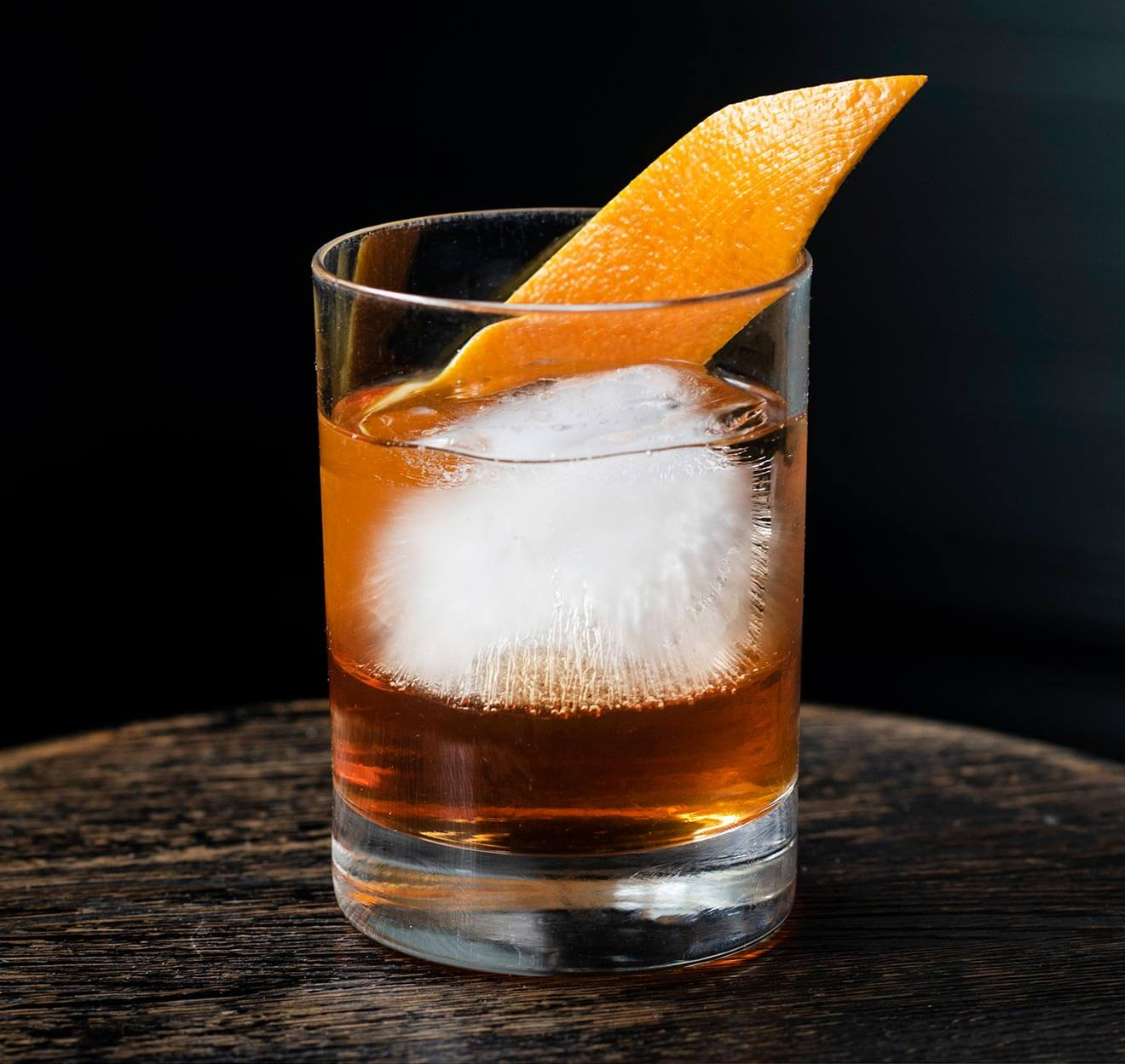 Sweater Weather cocktail with orange garnish
