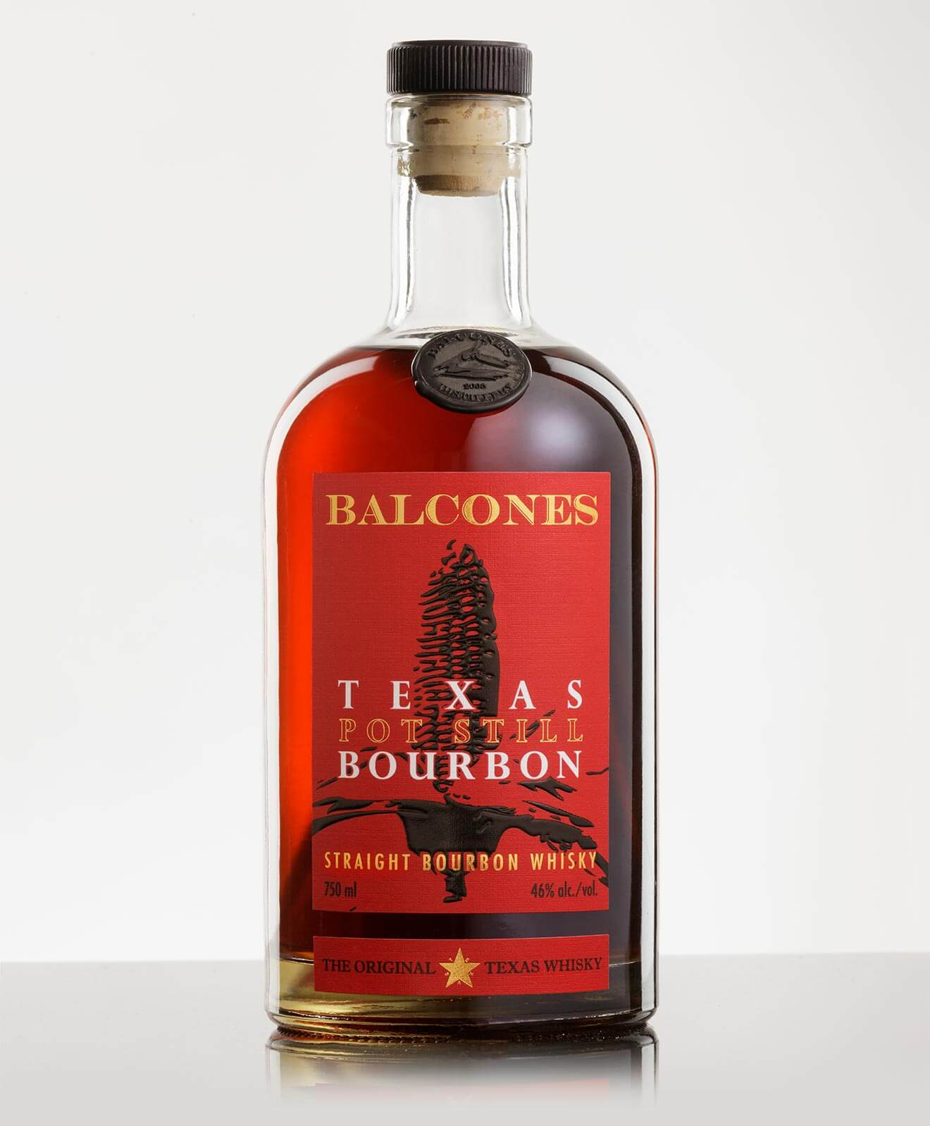 Balcones Distilling Texas Pot Still Bourbon, bottle with reflection on light back