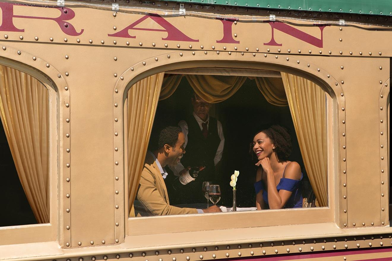Nappa Valley Wine Train, couple enjoying a window seat and glass of wine