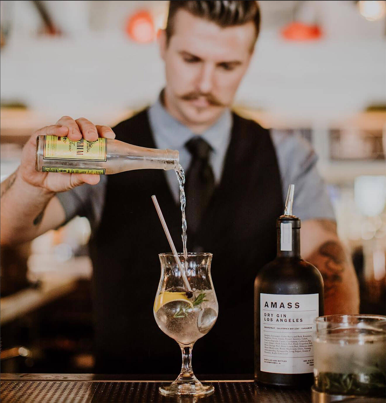 AMASS G&T, mixologist pouring