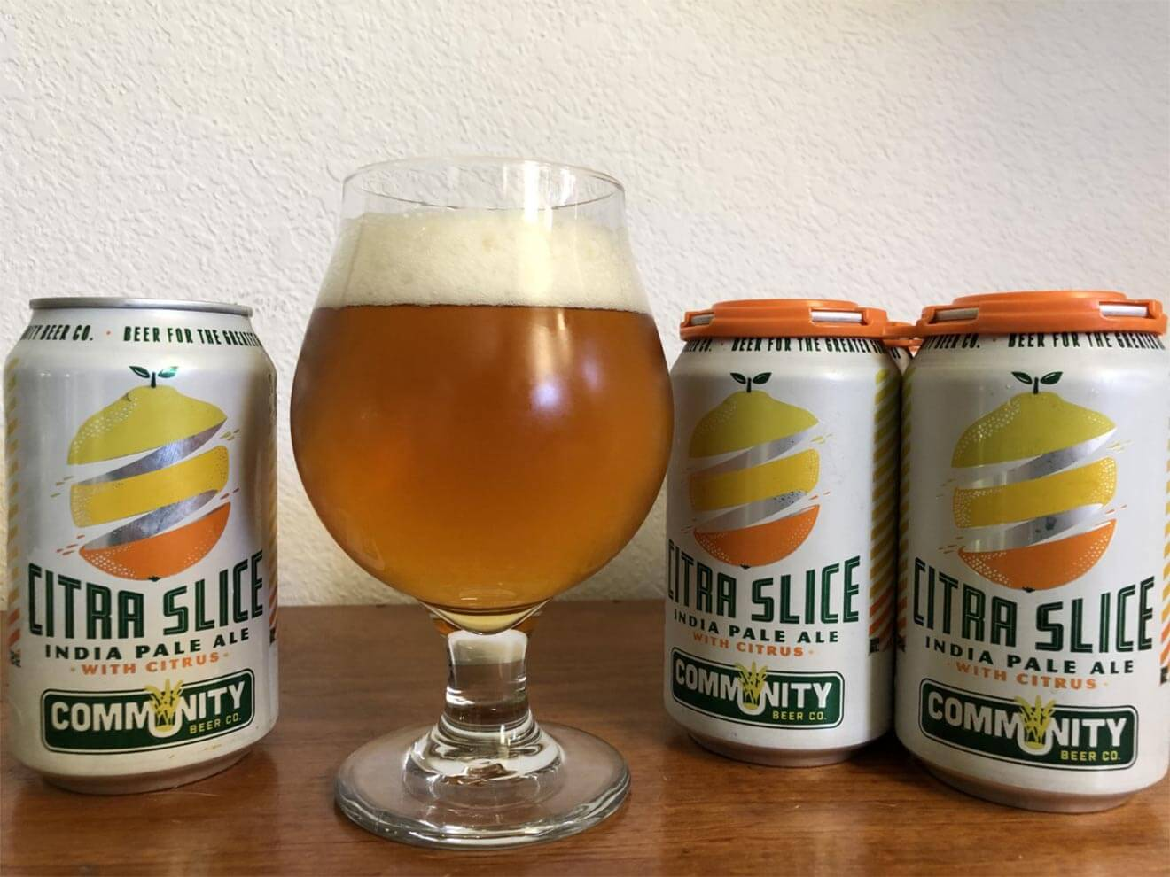 Community Beer Company Citra Slice IPA, glass and cans display