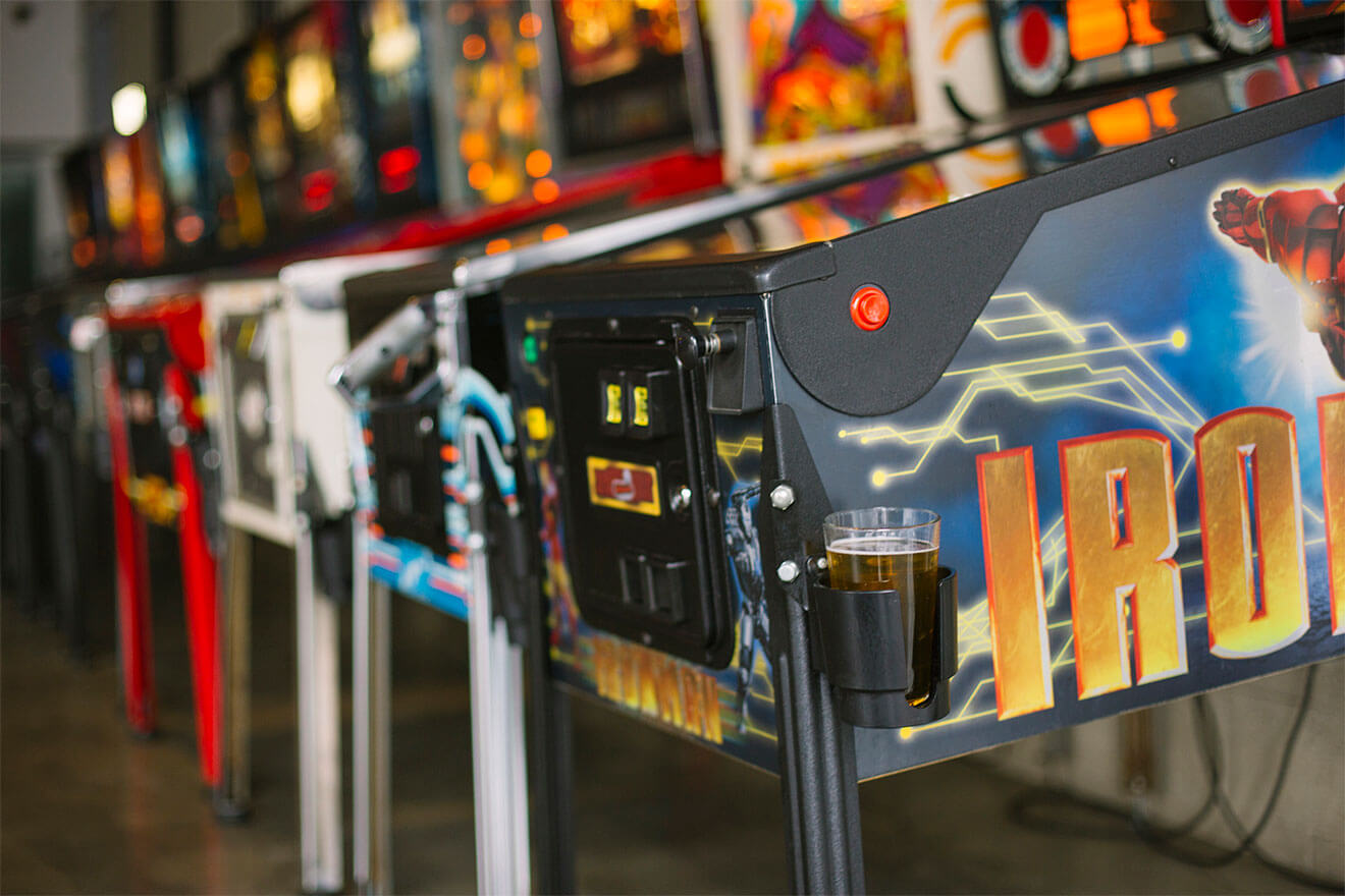 EightyTwo arcade, pinball machine with beer holder