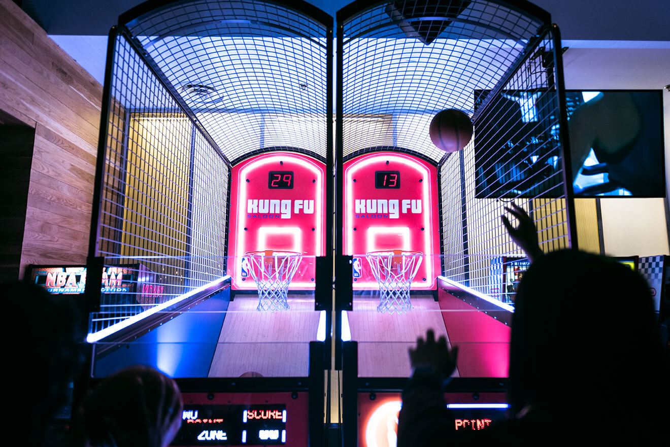 Kung Fu Saloon playing basketball on arcade game hoop