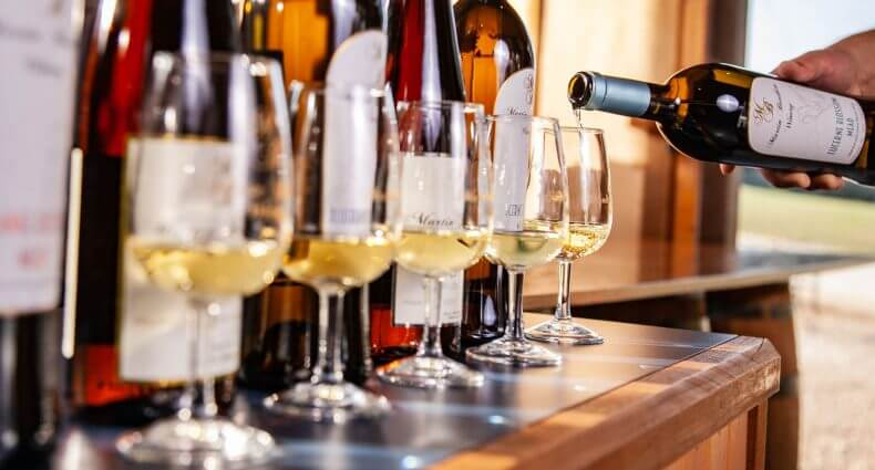 Martin Brothers WInery, bottles, pouring, featured image