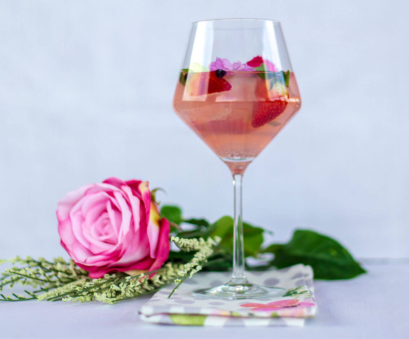 Spanish Rosa GinTonic, rose with cocktail, strawberry garnish