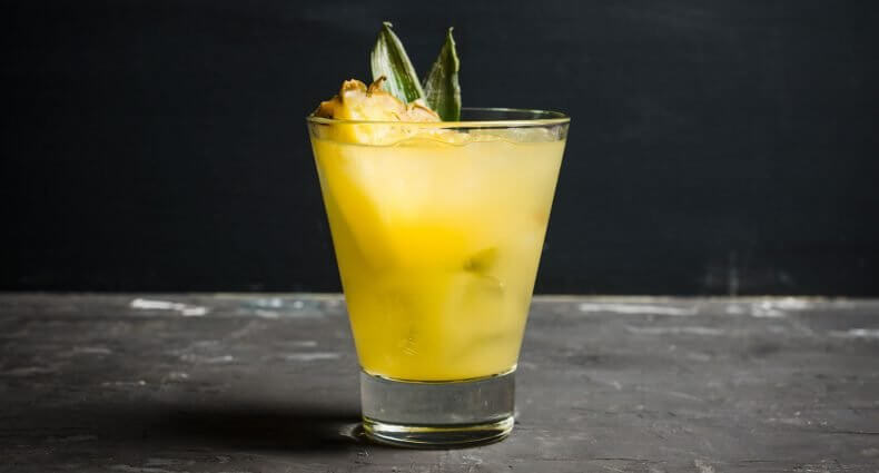 Best Mixers for Rum Cocktails, rum cocktail with garnish, featured image
