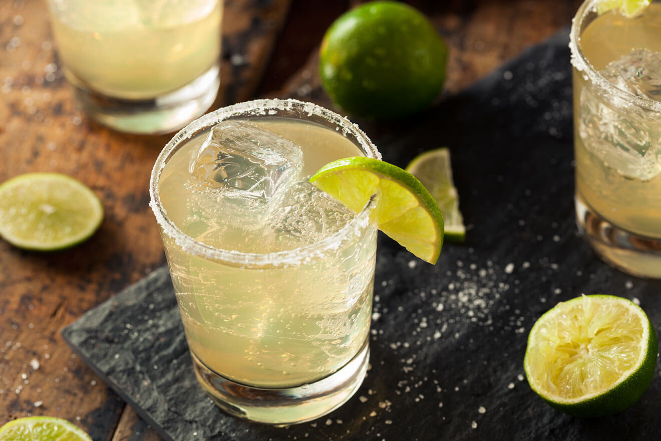 The Classic Margarita, cocktail with salt rim and lime wedge