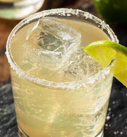 The Classic Margarita, cocktail with salt rim and lime wedge, featured image