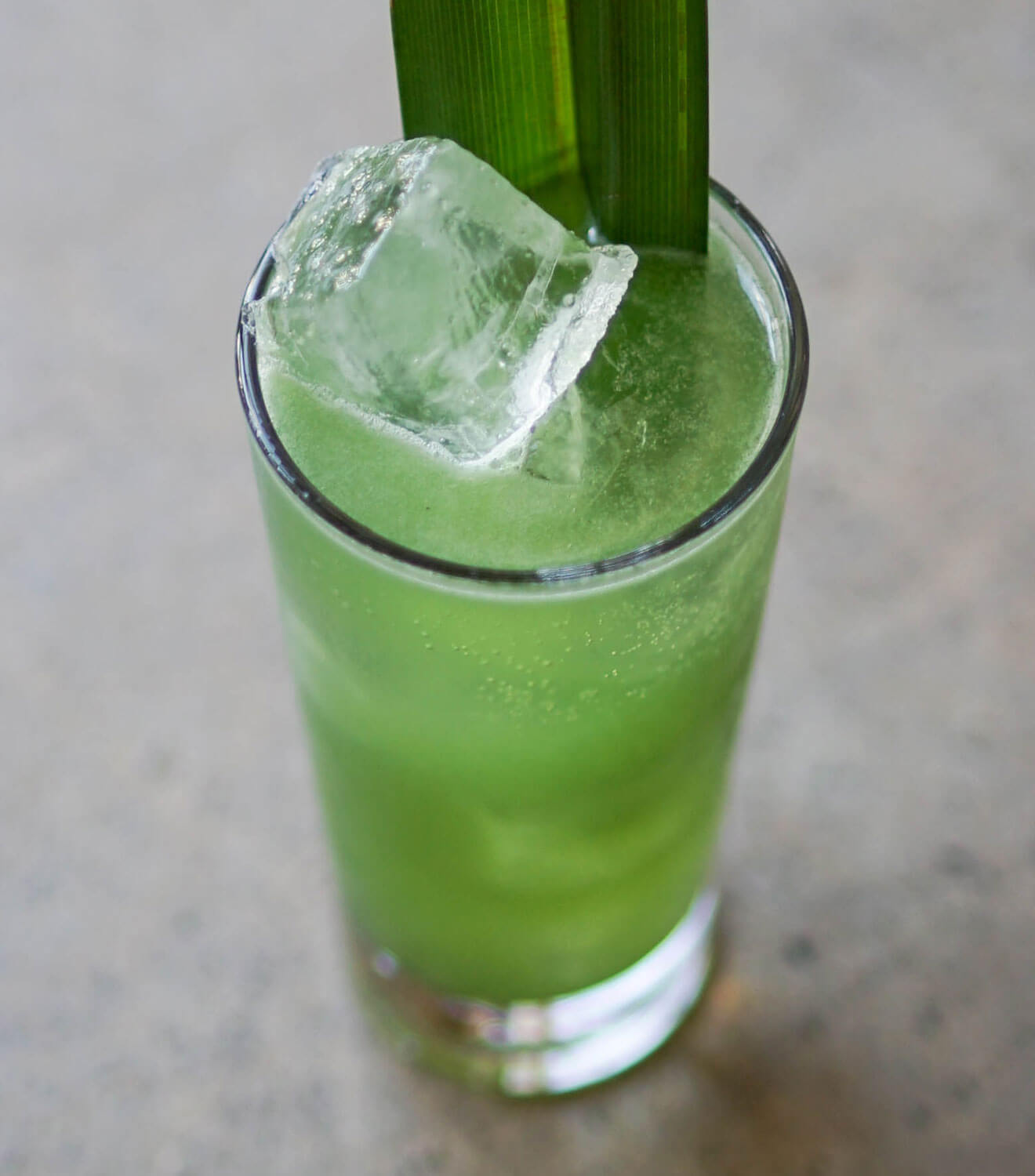 A&W Cocktail, green cocktail with large ice cubes