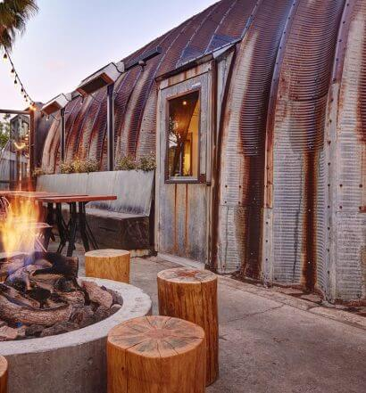 Campfire Exterior, firepit, tp and seating, featured image