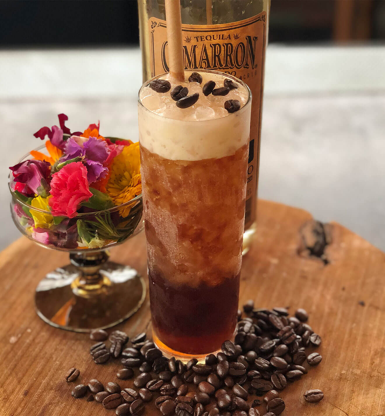 Cold Brew Carajillo, cocktail and bottle on serving tray