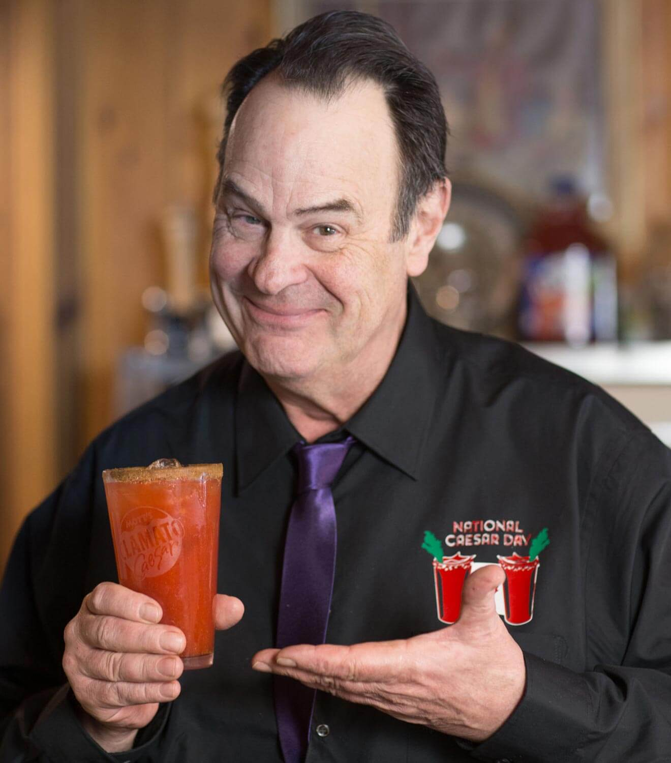Dan Aykroyd's Golden Caesar, presenting the cocktail with a smile