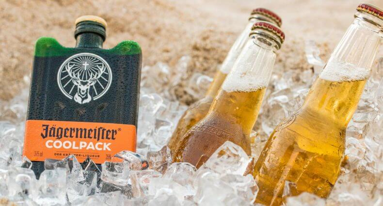 Jägermeister Coolpack, bottles and plastic glass in cooler with ice, featured image