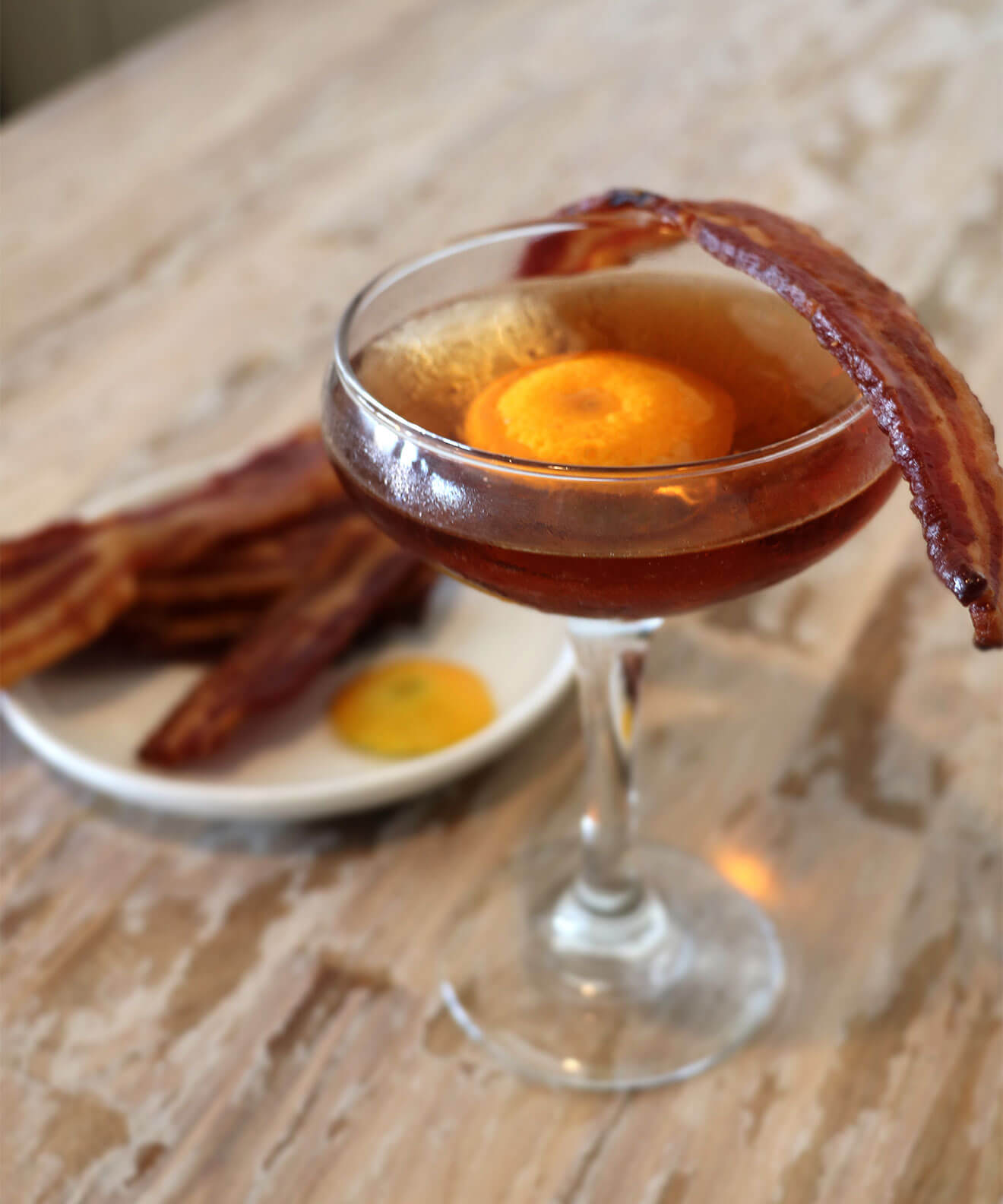 Maple Bacon Old Fashioned, cocktail with bacon garnish, breakfast on table