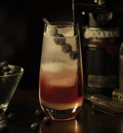 brockmans garden cocktail with garnish, dark background,featured image