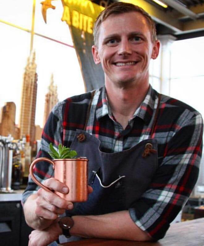 Lee Caldwell of Avanti, portrait with cocktail in hand