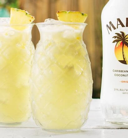 Malibu Piña Colada cocktails with bottle, featured image