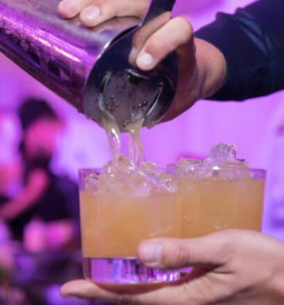 Pouring-cocktails-at-Wonder-of-the-Cocktail-featured image