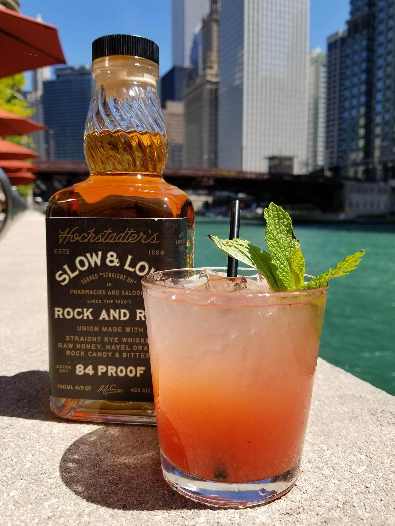 Strawberry Mint Julep, cocktail and bottle poolside