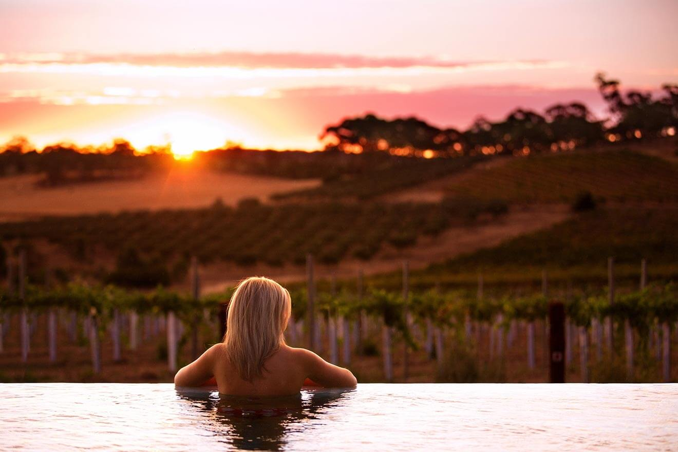 The Louise resort, woman in pool overlooking vineyards