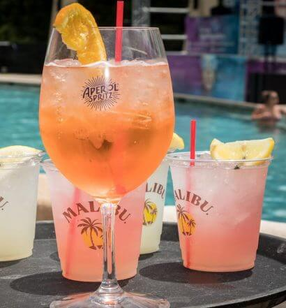 "Foxwoods Resort Casino's ""Splash Into Summer"" Pool Party, cocktails on serving tray, poolside"