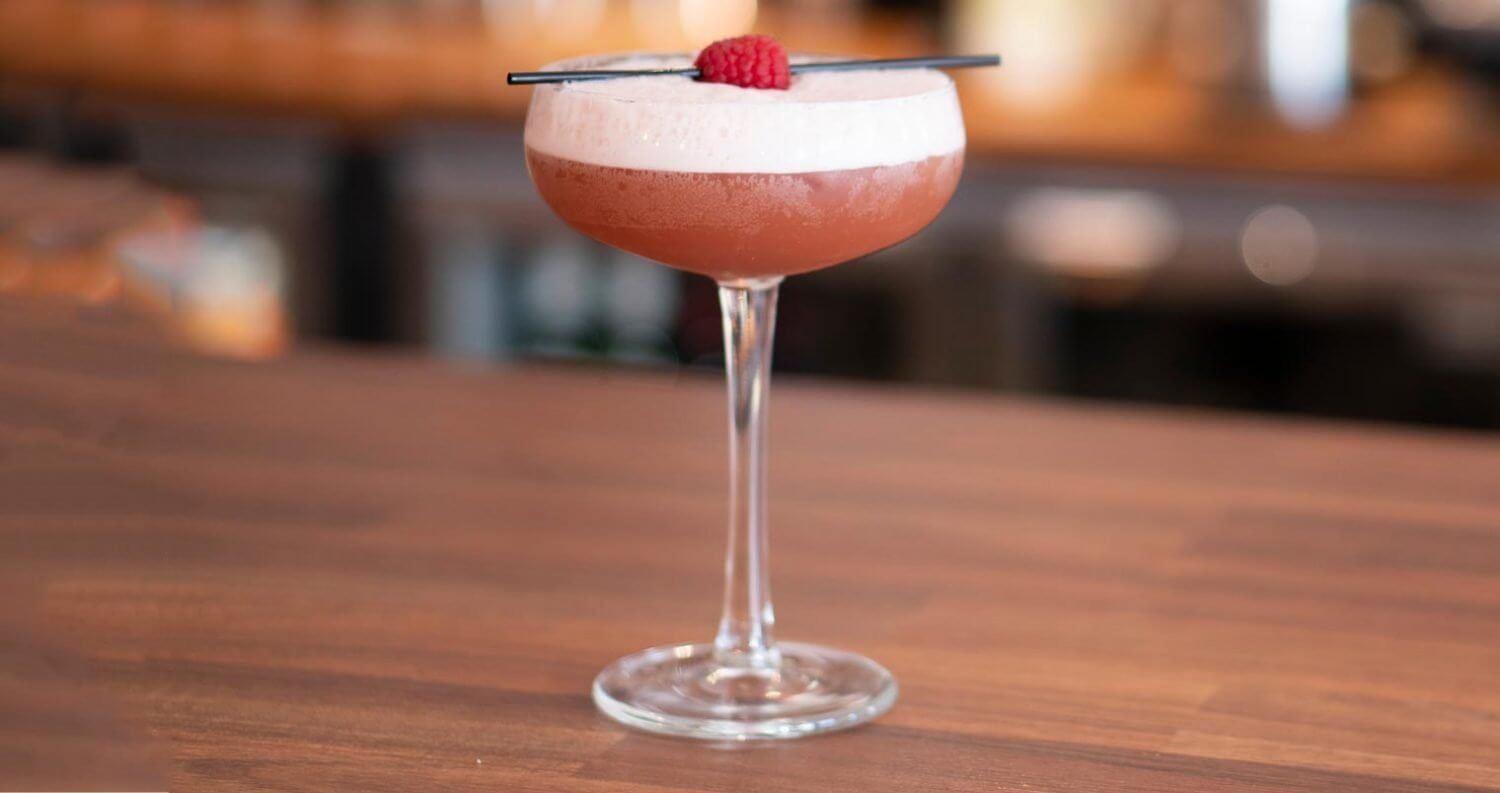 French Martini cocktail with garnish, bar top, featured image