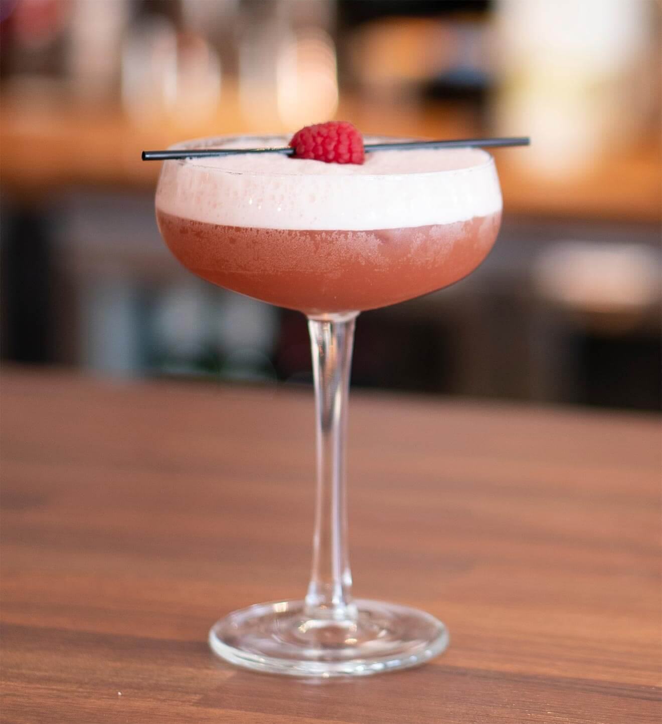 French Martini cocktail with garnish, bar top