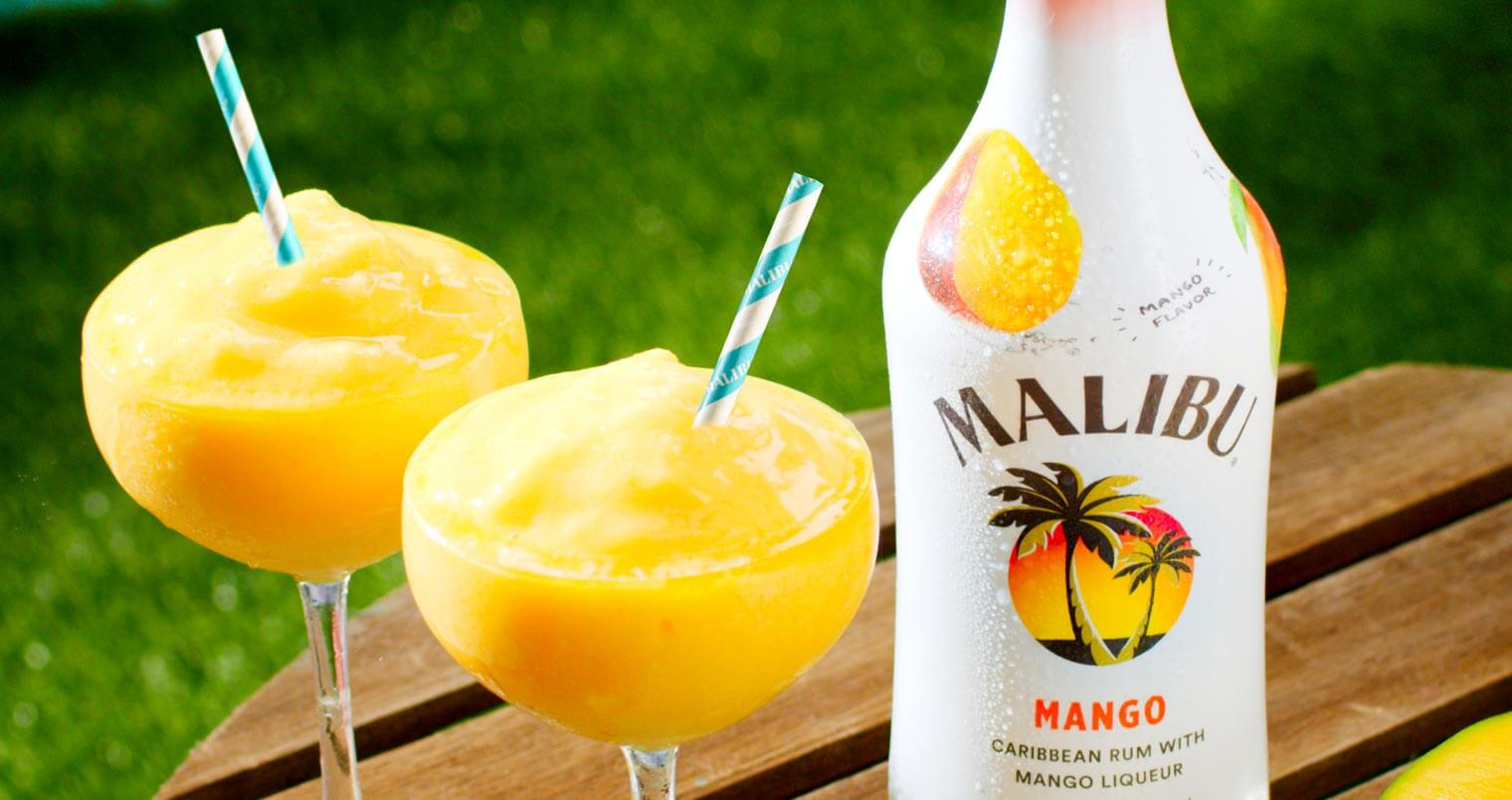 Malibu Mango Frozen Daiquiri, frozen cocktail with bottle, wooden round table, featured image