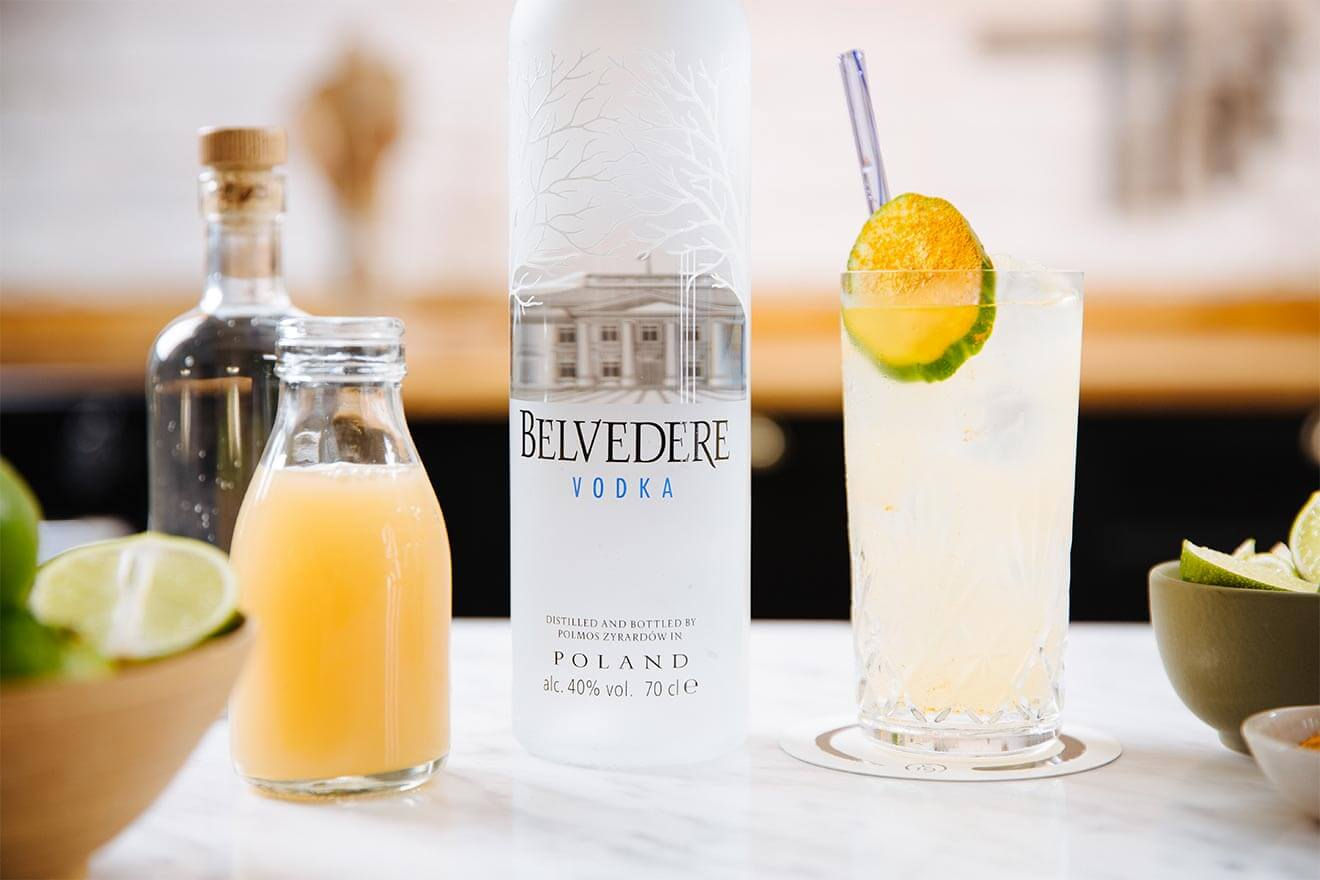 Belvedere Pomme Highball, kitchen display with bottle, garnishes and cocktail