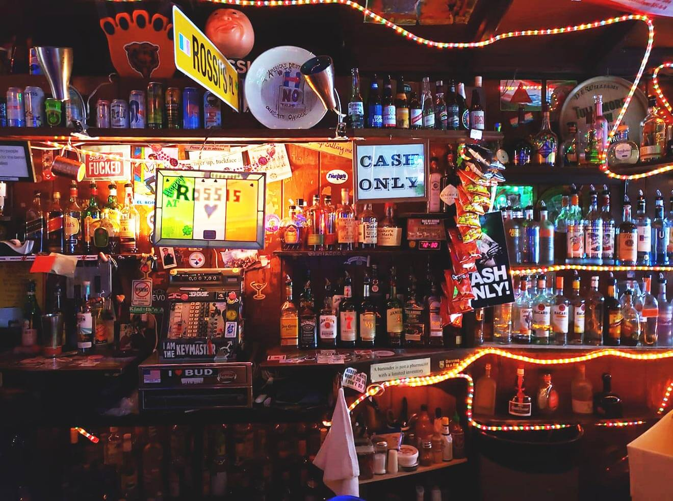 Rossi's Liquors, shelves with booze, bar