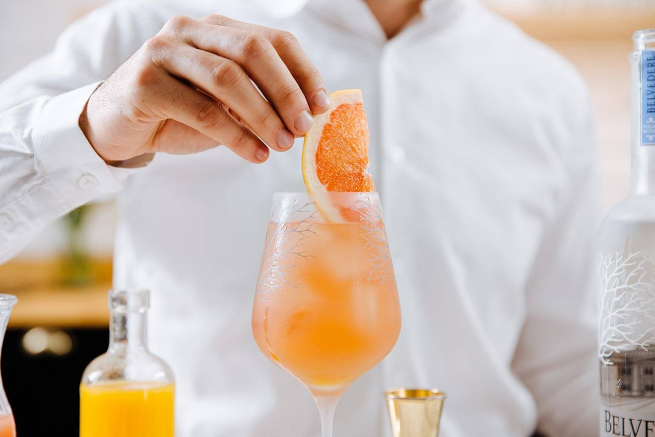 Belvedere Rubin Cocktail, kitchen display with bottle, garnishes and cocktail