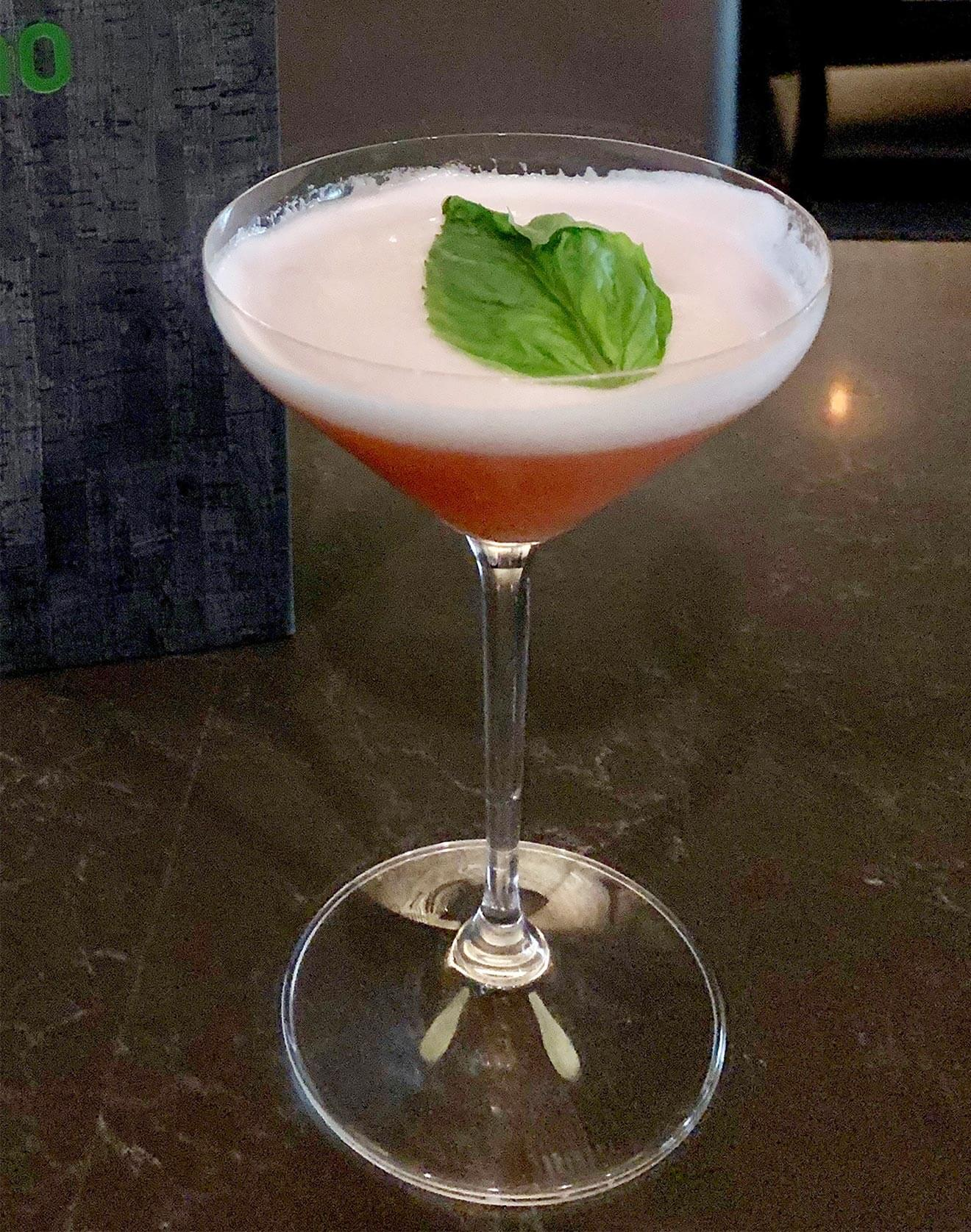NUE Sip of Liberty cocktail with leaf garnish