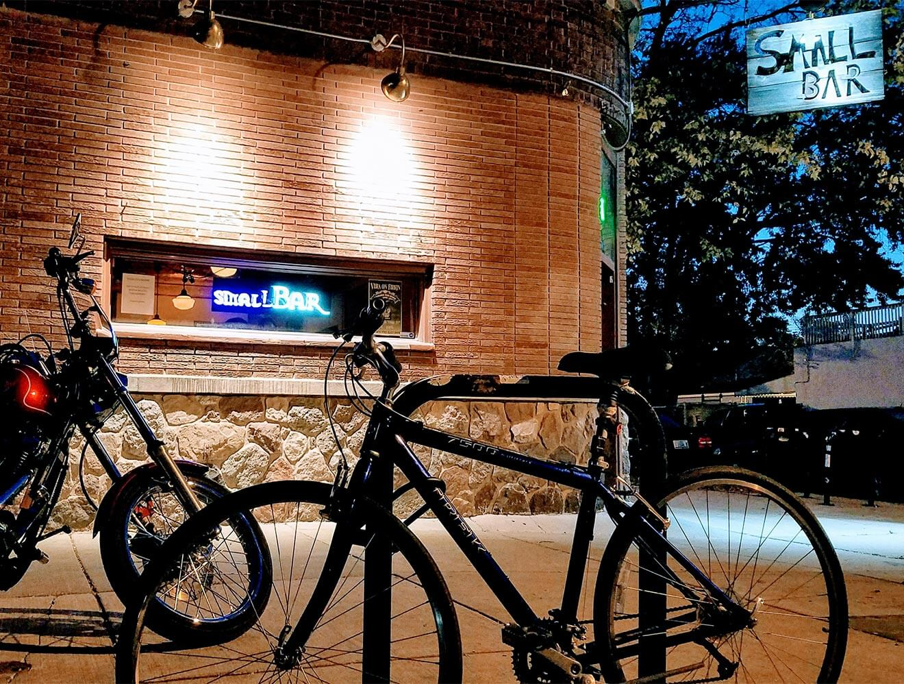 Small Bar, outside view, signage and bike rack