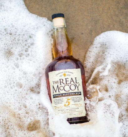 The Real McCoy 12 Year, bottle on shore, featured image